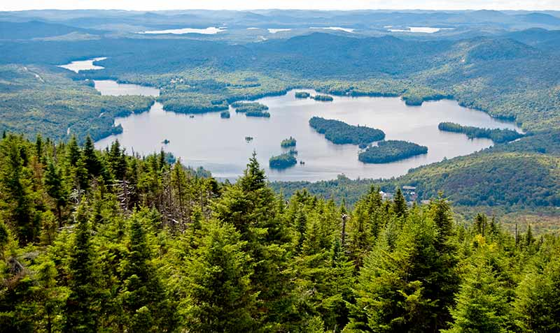 View of Blue Mountain Lake from the summit of Blue Mountain by Flickr user Nekenasoa