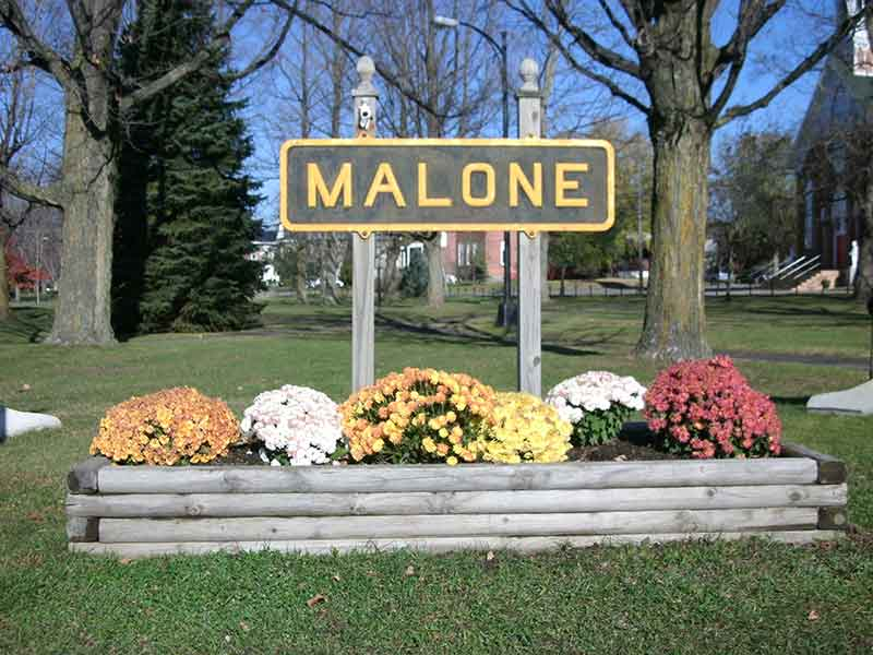 Town sign for Malone, NY