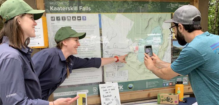 stewards at kaaterskill falls talk to a visitor