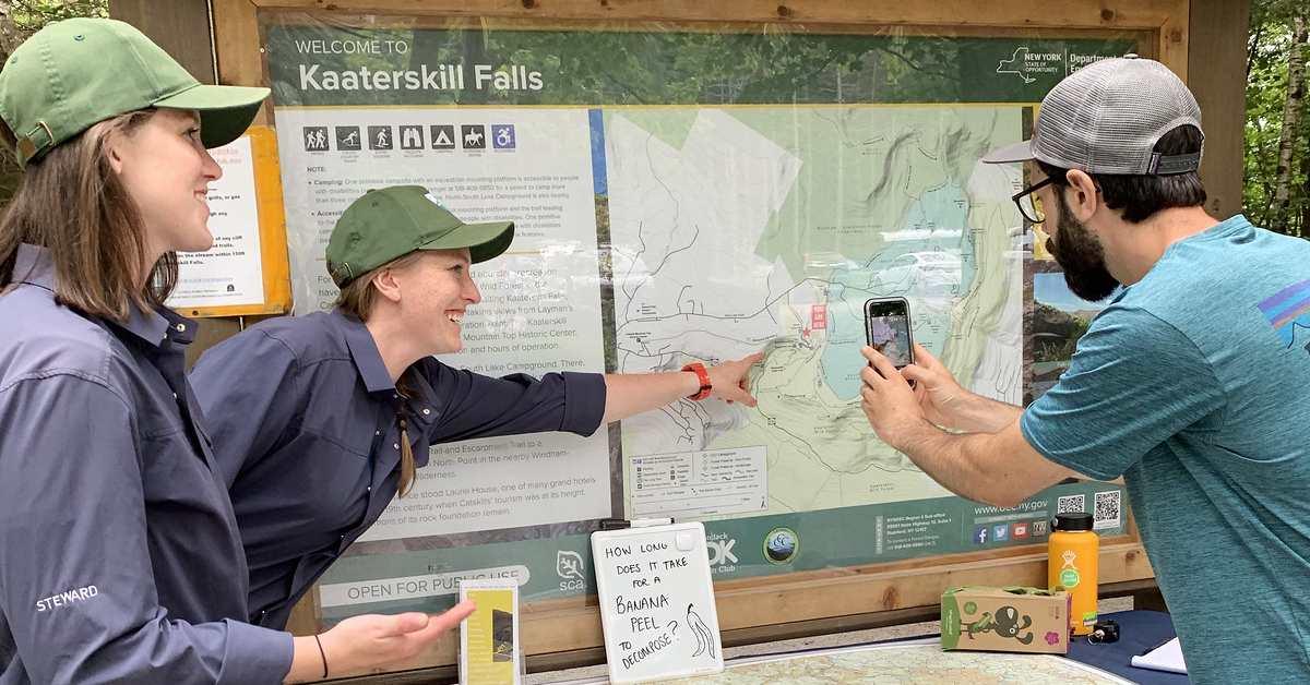 stewards at kaaterskill falls talk to a visitor