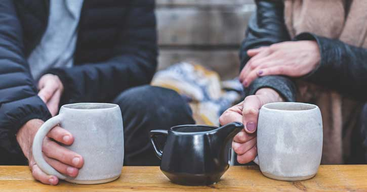 Two people enjoying cups of coffee