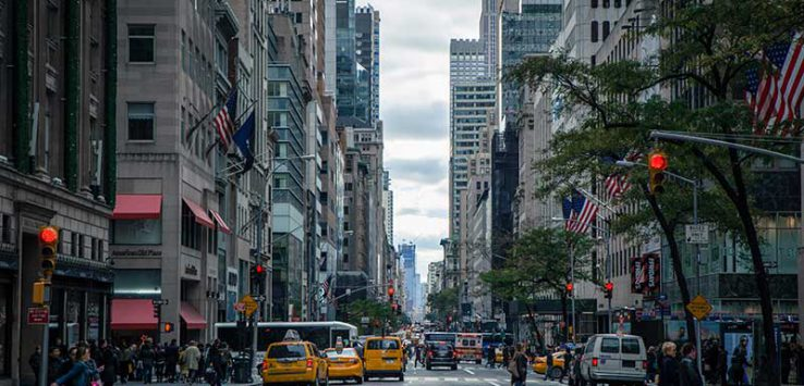Street in New York City filled with taxis and pedestrians