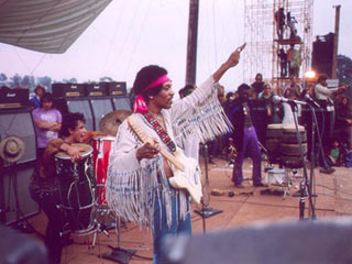 Jimi Hendrix on stage at the 1969 Woodstock Music Festival