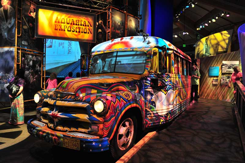 School bus painted with psychadelic motids on display at the Museum at Bethel Woods