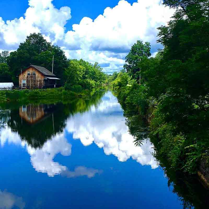 Clouds reflecting on the water at Chittenango Landing Boat Canal Museum
