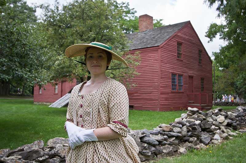 Woman dressed in 1800s clothing at the Genesee Country Village & Museum