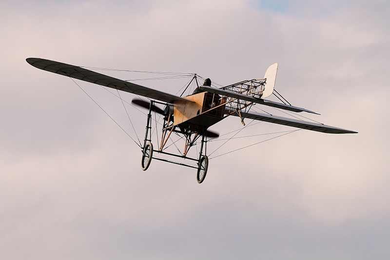 An early propeller plane in flight