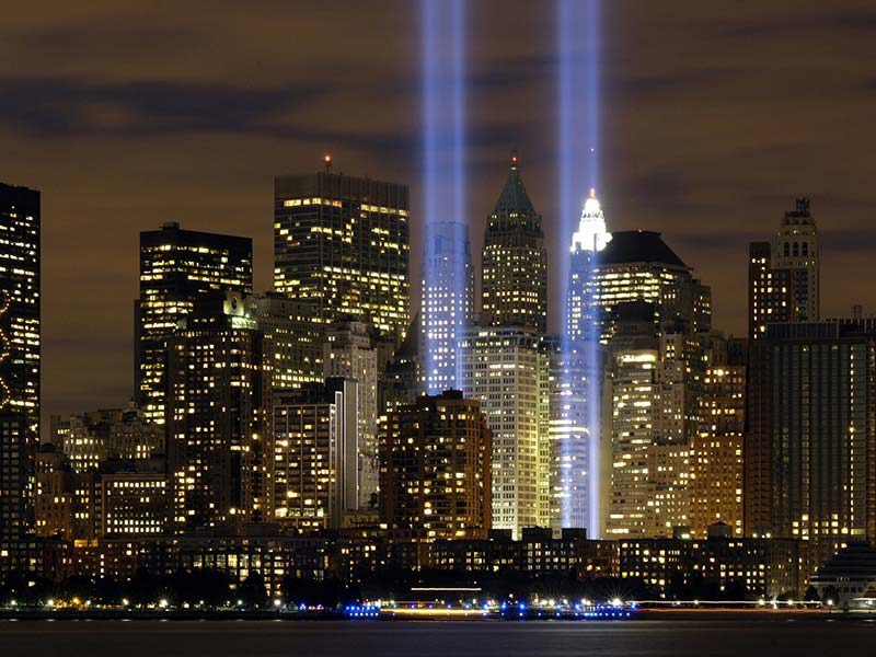 NYC Skyline at night with World Trade Center memorial lights