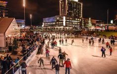 People ice skating at Canalside in downtown Buffalo