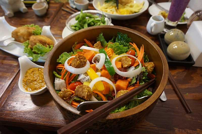 Bowl of vegan stir fry with tempeh